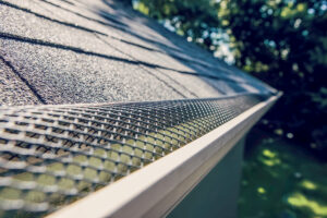 Gutter guard installed onto roofing